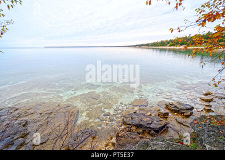 Quiet Waters on a Lake shore in the Fall on Whitefish Dunes Natural Area in Wisconsin - Stock Photo