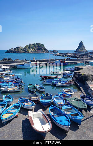 Harbour of fishing village Aci Trezza, behind the cyclops islands, comune of Aci Castello, Catania, Sicily, Italy - Stock Photo