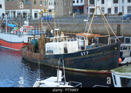 Old fishing vessel moored next to other boats in the harbour at Stornoway on the Isle of Lewis Outer Hebrides Scotland UK United Kingdom - Stock Photo
