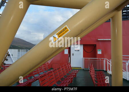 Structural steelwork and seating on upper deck of Caledonian MacBrayne calmac island ferry operating between Stornoway and Ullapool Western Scotland - Stock Photo