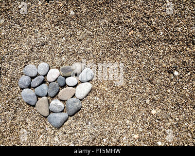 stones laid out in the shape of a heart. - Stock Photo