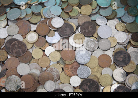 A collection of old world wide used coins. - Stock Photo