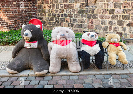 A line of well loved Teddy Bears brighten up a street in Nikolaiviertel Nicholas' Quarter, the old centre of Berlin, Germany. - Stock Photo