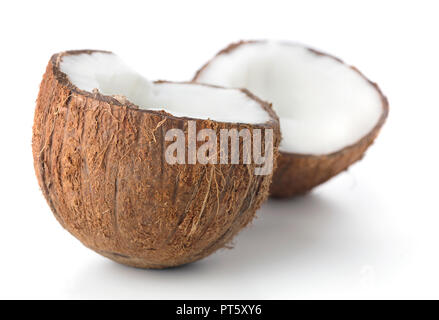 two cracked parts of coconuts isolated on white background - Stock Photo