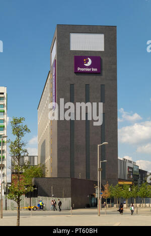 Sign and logo outside a Premier Inn hotel building owned by Whitbread in Wembley, London, UK - Stock Photo
