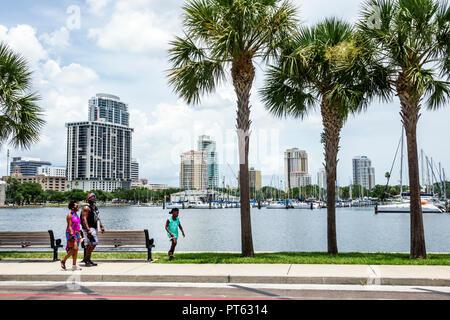 St. Saint Petersburg Florida Black family South Yacht Basin Tampa Bay Albert Whitted Park - Stock Photo