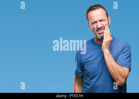 Middle age hoary senior man over isolated background touching mouth with hand with painful expression because of toothache or dental illness on teeth.