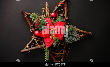 Christmas wreath with dry twigs, pine branches, red balls - Stock Photo