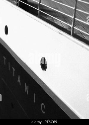 Close up of the Hull and Nameplate of a 1/20th scale custom built RMS Titanic model / miniature. showing portholes and a portion of deck railing. - Stock Photo