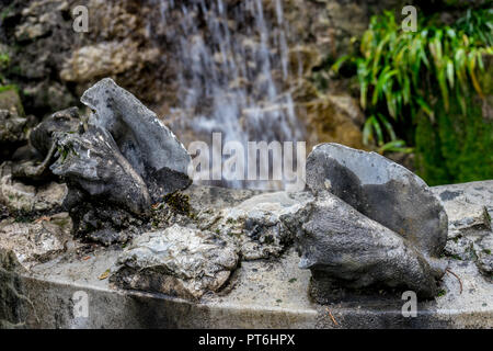 Italy, Varenna, Lake Como, a large waterfall over a conch - Stock Photo