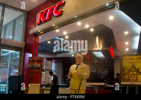 A Kentucky Fried Chicken fast food restaurant is part of the new and modern Aeon Mall shopping complex in Phnom Penh, Cambodia. - Stock Photo