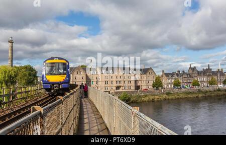 A train crosses the River Tay on the Friarton Bridge in the city of Perth in Scotland, UK - Stock Photo