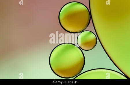 Macro photo of an Oil drops Bubbles on Water surface. - Stock Photo