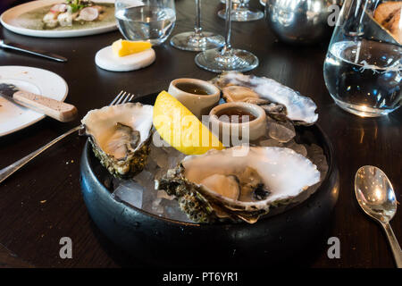 Lunch dishes at the Roux at the landau inThe Langham Hotel, UK. - Stock Photo