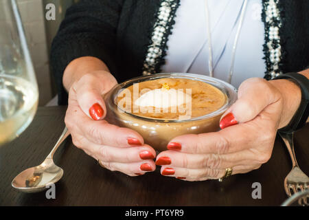 Lunch dishes at the Roux at the landau inThe Langham Hotel, UK. Woman cupping hands around dish - Stock Photo