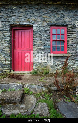Vintage door and window on a facade of an old cottage in Ireland - Stock Photo