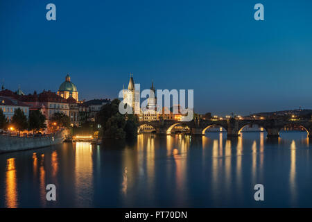 Charles bridge in Prague at night - Stock Photo