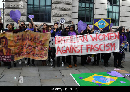 London, UK. 7th Oct 2018. Brazilian women agaimst fascism counter far-rights outside Brazil embassy will the Brazilian people queuing to vote for the Brazil election in London, UK. 7 October 2018. Credit: Picture Capital/Alamy Live News - Stock Photo
