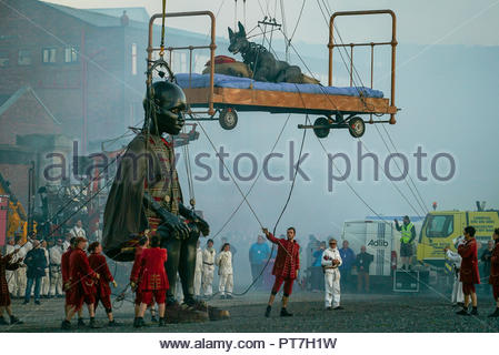 Liverpool, UK. 7th Oct 2018. All 3 Giants meet at Sunset on Saturday by Clarence Dock, Liverpool, UK Credit: ArvydasKizevicius/Alamy Live News - Stock Photo