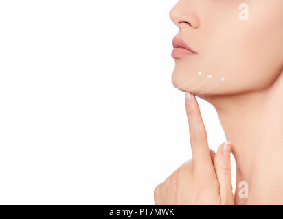 Cropped beautiful woman face with arrows , lifting skin on neck and chin line - Stock Photo