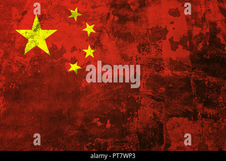 National flag of China on the background of the old wall covered with peeling paint - Stock Photo