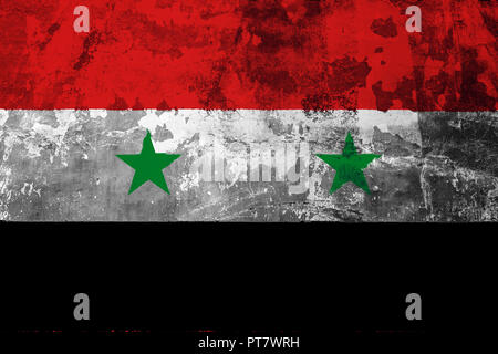 National flag of Syria on the background of the old wall covered with peeling paint - Stock Photo