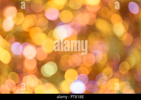 Background texture full of unsharp blurring golden yellow and cute pink shining bokeh lens aesthetic aberration effect. - Stock Photo
