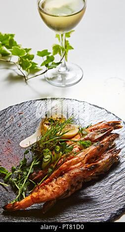Grilled shrimp skewers. Seafood, shelfish. Shrimps Prawns skewers with herbs, garlic and lemon. - Stock Photo