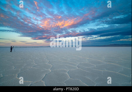 Photographer takes pictures of the beautiful sunrise on the Bonneville Sale Flats in Utah - Stock Photo