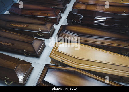 Coffins in the funeral shop - Stock Photo