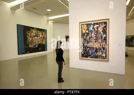A person watching Marilyn by Mimmo Rotella, Museum of Modern and Contemporary Art (MAMAC), Nice, France - Stock Photo