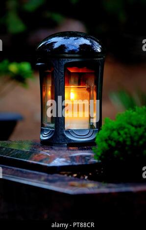 grave lantern with burning candle - Stock Photo