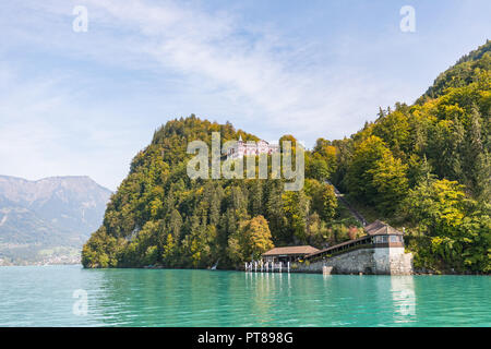 View from a boat over the turquoise lake Brienz to grand hotel giessbach in switzerland - Stock Photo