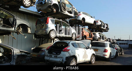 Old Cars in a scrap yard - Stock Photo