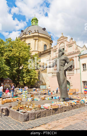 Lviv, Ukraine - July 10, 2015: Book and antique market near monument to Ivan Fedorov, one of the founders of Eastern Slavonic printing, the first prin - Stock Photo