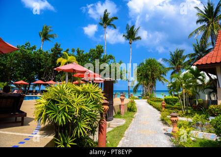 Bungalows and palms, Haad Yao beach, Koh Phangan island, Suratthani, Thailand - Stock Photo