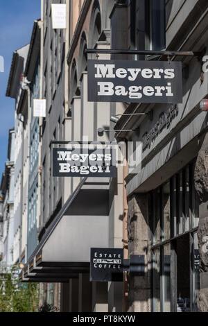 Meyers Bageri (Meyer's Bakery), signs outside Claus Meyer bakery shop in Store Kongensgade, Copenhagen, Denmark - Stock Photo