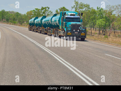 Road Train  travelling at speed through Litchfield Park region in the Northern Territory of Australia - Stock Photo