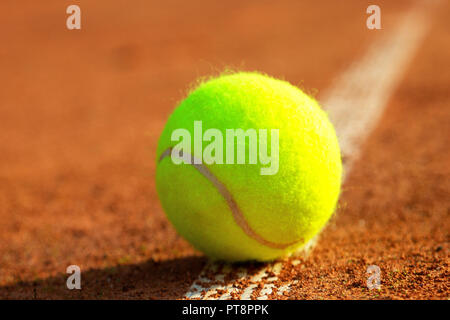 close-up tennis ball and net on court - Stock Photo