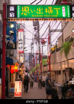 Tokyo, Japan. September 11, 2018. Omoide Yokocho alley in Shinjuku. Omoide yokocho has many small bars and restaurants providing a delightful journey  - Stock Photo