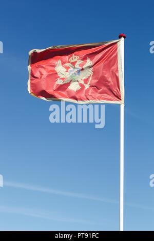 Flag of Montenegro waving in the sky - Stock Photo