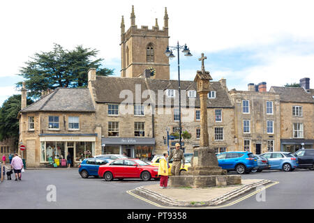 Market Cross and St Edward's Church tower, Market Square, Stow-on-the-Wold, Gloucestershire, England, United Kingdom - Stock Photo