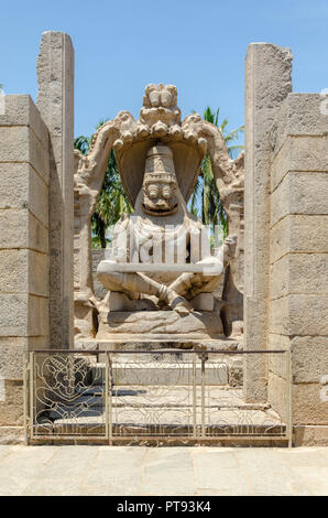 Fierce Yoga - Narasimha monolith, the man - lion avatar of Vishnu, seated in yoga position at Hampi, Karnataka, India. - Stock Photo