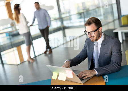 Young business man leadership of big successful enterprise is checking the status of bank account - Stock Photo