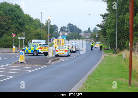 Emergency services at the scene of an accident involving a motorcycle on Pontefract Road in Knottingley,West Yorkshire. - Stock Photo
