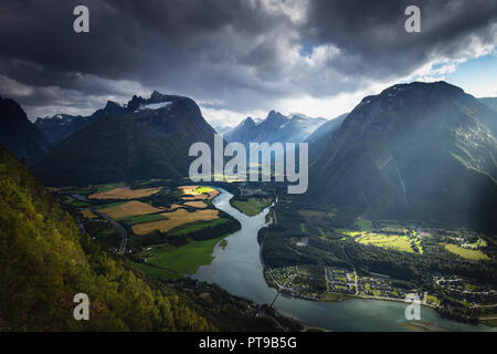 Epic view from the romsdalstrappa view point on Romsdalen valley, river Rauma and Isterdalen valley in a far. Romsdal mountains, Norway. - Stock Photo