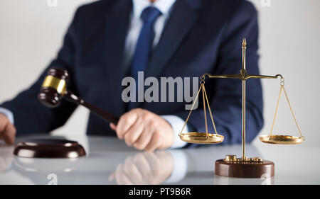 Man in suit on white background. Law business concept. Judge gavel, scale of justice and legal code. - Stock Photo