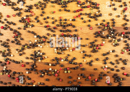 Five Pepper Mix Whole Peppercorns. Black White Green Red Peppercorns - Stock Photo