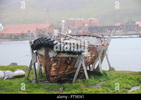 An Old Lifeboat on a rainy day in Grytvyken, the Capitol of the island of South Georgia. - Stock Photo