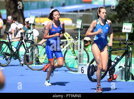 Buenos Aires, Argentina. 7th Oct, 2018. Yu Xinying (L) of China competes during the Women's Triathlon match at the 2018 Summer Youth Olympic Games in Buenos Aires, capital of Argentina, Oct. 7, 2018. Yu Xinying ranked the 20th with 1 hour 2 minutes 49 seconds. Credit: Li Jundong/Xinhua/Alamy Live News - Stock Photo
